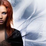 Fashion shoot of a mystique redhead woman Stock Photos