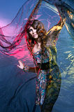 Fashion shoot of a woman in a colorful dress Royalty Free Stock Images