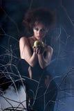 Fashion shoot of a woman in a dark dress Stock Photos
