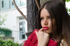 Fashion shoot woman with red handbag Royalty Free Stock Photo