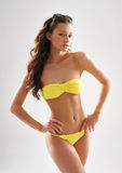 Fashion shoot of a woman in a yellow swimsuit Stock Photo