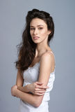 Fashion shoot of a young brunette Caucasian woman Stock Photos