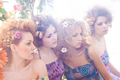Fashion shoot of young nymphs in a flower forest Royalty Free Stock Photo