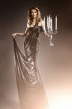 Fashion shoot of a young redhead woman in a dress Royalty Free Stock Photos