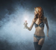 Fashion shoot of a young redhead woman Stock Image