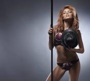 Fashion shoot of a young striptease dancer Stock Photos