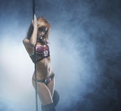 Fashion shoot of a young striptease dancer Stock Photos