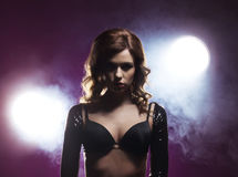 Fashion shoot of a young woman in a black bra Royalty Free Stock Photo