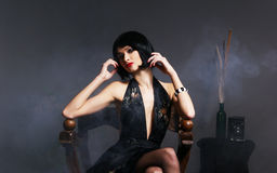 Fashion shoot of a young woman in a black dress Royalty Free Stock Photos
