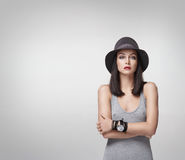 Fashion shoot of a young woman in a black hat stock photos