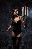 Fashion shoot of a young woman in dark lingerie Stock Photo