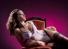 Fashion shoot of a young woman in erotic lingerie Stock Photos