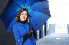 Fashion shoot of a young woman holding an umbrella Royalty Free Stock Photography