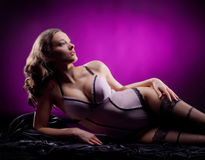 Fashion shoot of a young woman laying in lingerie Royalty Free Stock Photography