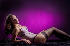 Fashion shoot of a young woman laying in lingerie Stock Photo