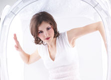Fashion shoot of a young woman in a light cube Royalty Free Stock Photography