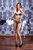 Fashion shoot of a young woman in pin-up style Royalty Free Stock Photos