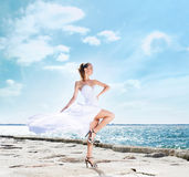 Fashion shoot of a young woman on a sea background Stock Photography