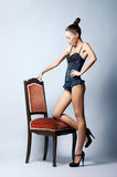 Fashion shoot of a young woman in sexy clothes Royalty Free Stock Image