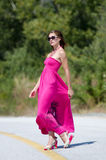 Fashion shoot of young woman wear long red dress Stock Photography