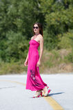 Fashion shoot of young woman wear long red dress Royalty Free Stock Photos