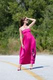 Fashion shoot of young woman wear long red dress Royalty Free Stock Photo