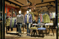 Fashion shop  clothing store. Interior of men's clothing store in Hongkong center,go shopping in China,Asia Royalty Free Stock Photo