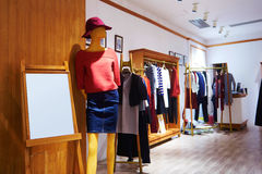 Fashion shop  clothing store. View of womens fashion clothing store  front,Woman mannequin in fashion clothing retail shop Royalty Free Stock Photos