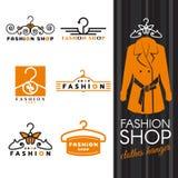 Fashion shop logo - orange shirts and Clothes hanger logo vector set design Royalty Free Stock Images