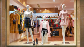Fashion shop window clothing store front. View of womens fashion clothing store  front,Woman mannequin in fashion clothing retail shop window Royalty Free Stock Photography
