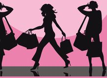 Fashion shopping. Vector illustration of the female silhouettes with shopping bags Royalty Free Stock Photography