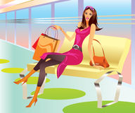 Fashion shopping girl with bag relax in mall Stock Photography