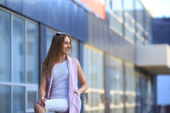 Fashion Shopping Girl Portrait. Beautiful girl in sunglasses. Smiling woman.  Royalty Free Stock Photo