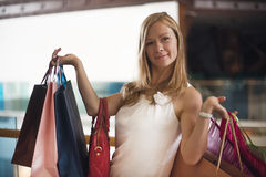 Fashion Shopping Girl Portrait. Beauty Woman with Shopping Bags in Shopping Mall Stock Image