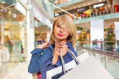 Fashion Shopping Girl Portrait. Beauty Woman with Shopping Bags in Shopping Mall. Shopper. Sales. Shopping Center Royalty Free Stock Image