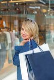 Fashion Shopping Girl Portrait. Beauty Woman with Shopping Bags in Shopping Mall. Shopper. Sales. Shopping Center Stock Image