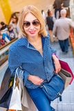 Fashion Shopping Girl Portrait. Beauty Woman with Shopping Bags in Shopping Mall. Shopper. Sales. Shopping Center Stock Photography