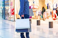 Fashion Shopping Girl Portrait. Beauty Woman with Shopping Bags in Shopping Mall. Shopper. Sales. Shopping Center Royalty Free Stock Photos