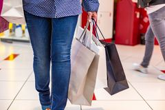 Fashion Shopping Girl Portrait. Beauty Woman with Shopping Bags in Shopping Mall. Shopper. Sales. Shopping Center Royalty Free Stock Photo