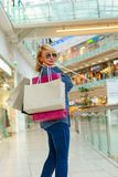 Fashion Shopping Girl Portrait. Beauty Woman with Shopping Bags in Shopping Mall. Shopper. Sales. Shopping Center Royalty Free Stock Images