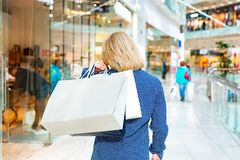 Fashion Shopping Girl Portrait. Beauty Woman with Shopping Bags in Shopping Mall. Shopper. Sales. Shopping Center Stock Photos