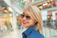 Fashion Shopping Girl Portrait. Beauty Woman in Shopping Mall. Shopper. Sales. Shopping Center Royalty Free Stock Image