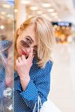 Fashion Shopping Girl Portrait. Beauty Woman smiling and looking over the glasses in Shopping Mall. Shopper. Sales. Fashion Shopping Girl Portrait. Beauty Woman Royalty Free Stock Photo