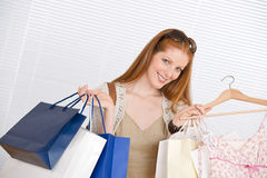 Fashion shopping - Happy woman with bag and dress Royalty Free Stock Images