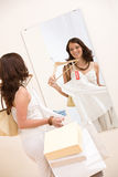 Fashion shopping - Happy woman choose sale clothes Royalty Free Stock Image