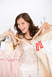 Fashion shopping - Happy woman choose sale clothes Stock Images