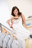 Fashion shopping - Happy woman choose sale clothes Royalty Free Stock Photos