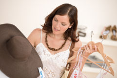 Fashion shopping - Happy woman choose sale clothes Stock Photo