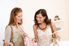 Fashion shopping-Two Happy woman choose clothes Royalty Free Stock Photos