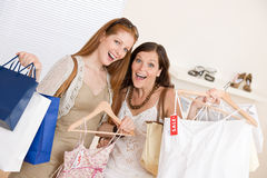 Fashion shopping -  Two happy woman choose clothes Stock Photo